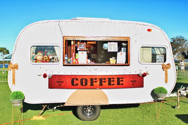 Campervan Cafe Parked On Grassy Field