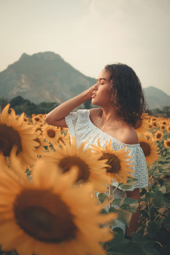 Tourists enjoy with the sunflower field.Tourists are happy to travel to find new experiences Hairstyle Women One Person Colorful Floral Nature Summer Sunflower Yellow Leaf Portrait Portrait Of A Woman Garden Green Color Growth Meadow Outdoors Agriculture Green Young Organic Field Plant Plantation Backgrounds