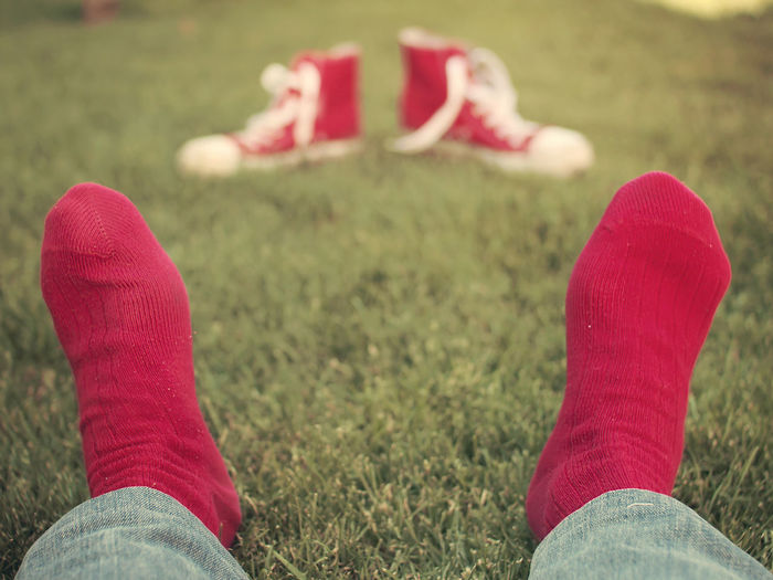 The guy with red socks Feet Grass Human Leg Jeans Outdoors Real People Red Sneakers Socks Vintage