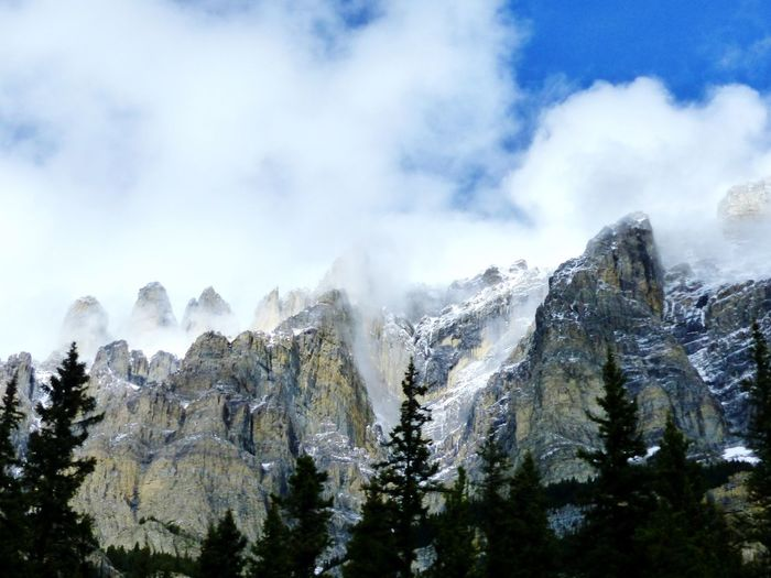 Rocky Mountains Mountain Cloud - Sky Cold Temperature Beauty In Nature Scenics Majestic Mountain Range Snowcapped Mountain Travel Photography Nature Outdoors Travel Destinations Banfftourism Weather Season  Sky Cloudy Blue Sky Sky And Clouds Rugged Beauty mountain air Nature Beauty In Nature