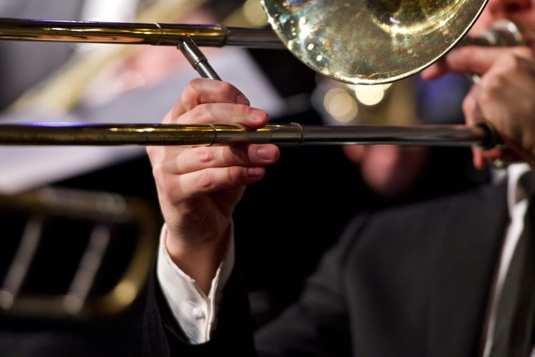 Big band music Arts Culture And Entertainment Close-up Day Focus On Foreground Holding Human Body Part Human Hand Indoors  Men Music Musical Instrument Musician One Person People Playing Real People Skill  Trombone Trombonist Wind Instrument