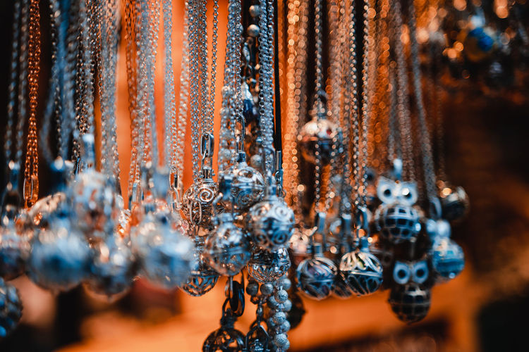 Close-Up Of Decorations Hanging On Metal For Sale