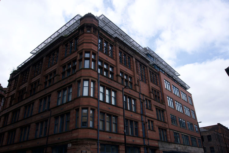 Architectural detail in Manchester, UK Manchester Northern Quarter Sky Architecture Building Exterior Built Structure Low Angle View Cloud - Sky Nature Day Window No People Building Outdoors City Brown Residential District High Section In A Row Old History Order Apartment