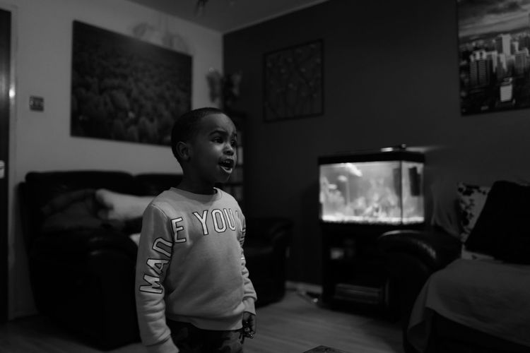 Boy standing at home