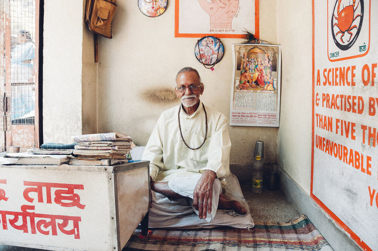 Everyday Lives India Indian Culture  Man Palmistry The Week On EyeEm Travel Day Esoteric Explore Fortune Fortuneteller Indoors  Looking At Camera Old One Person People Portrait Real People Religion Rishikesh Sitting Text Travel Destinations Wise