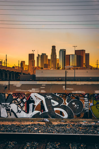The City of Angels Sky Architecture Sunset Building Exterior Built Structure City Nature Orange Color No People Building Urban Skyline Office Building Exterior Railroad Track Rail Transportation Transportation Outdoors Track Skyscraper Cityscape Tall - High