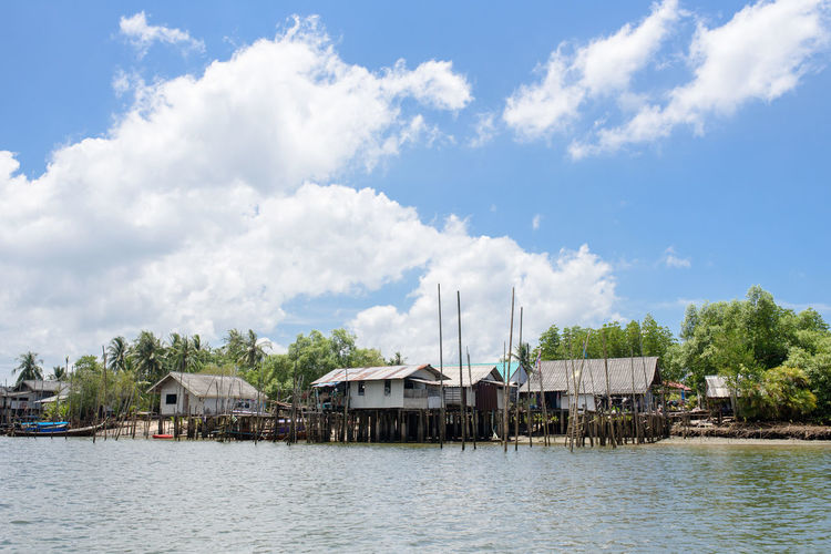Architecture Boathouse Building Building Exterior Built Structure Cloud - Sky Day House Nature No People Outdoors Plant Residential District River Sky Stilt Stilt House Tree Water Waterfront