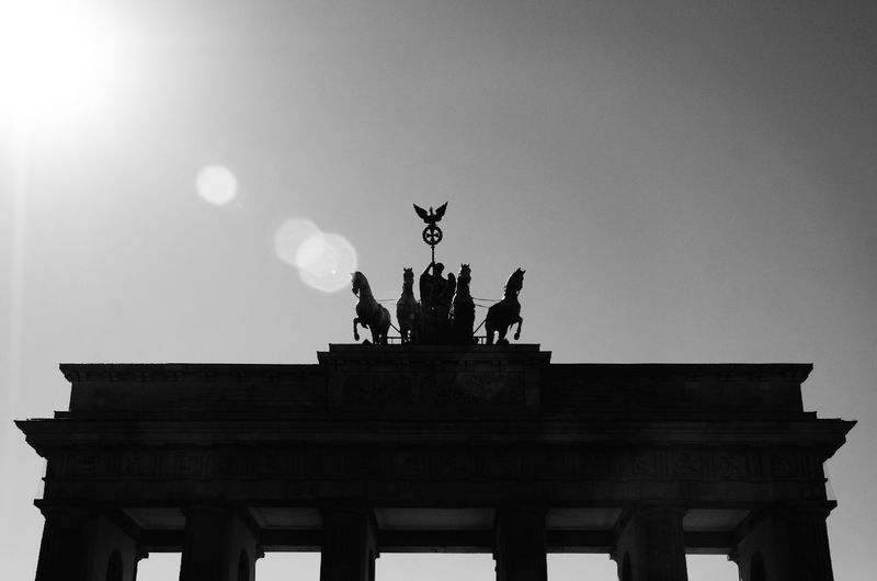 Architectural Column Architecture Art And Craft Black And White Blackandwhite Blackandwhite Photography Brandenburger Tor Built Structure Capture Berlin City City Gate Day Horse Low Angle View No People Outdoors Quadriga Sculpture Sky Statue Sun Reflection Tourism Travel Destinations The City Light Welcome To Black The Architect - 2017 EyeEm Awards The Street Photographer - 2017 EyeEm Awards Neighborhood Map Live For The Story Sommergefühle Your Ticket To Europe Discover Berlin Black And White Friday #FREIHEITBERLIN Summer In The City