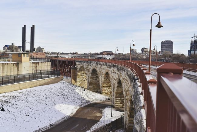 historic walking bridge across Mississippi River Bradleywarren Photography Bradley Olson Minneapolis Minnesota Stone Arch Bridge Historical Backgrounds Background Scenics Snowflakes Snow Modern Winter Graphics Landscape City City Life Bridge - Man Made Structure Bridge The Way Forward Looking Into The Future Stone Material Walking Sky Day Outdoors Water City No People Architecture