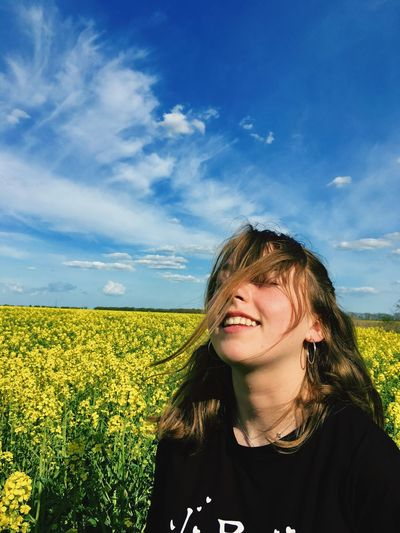 Sky Field One Person Land Plant Real People Cloud - Sky Leisure Activity Front View Growth Headshot Beauty In Nature Lifestyles Nature Young Adult Outdoors Hairstyle Adult Portrait Women