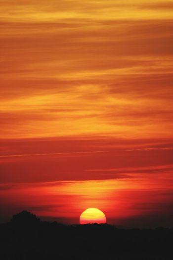 Sunset Sky Beauty In Nature Silhouette Scenics - Nature Tranquil Scene Orange Color Cloud - Sky Tranquility Idyllic No People Nature Non-urban Scene Outdoors Dramatic Sky Landscape Majestic Sun