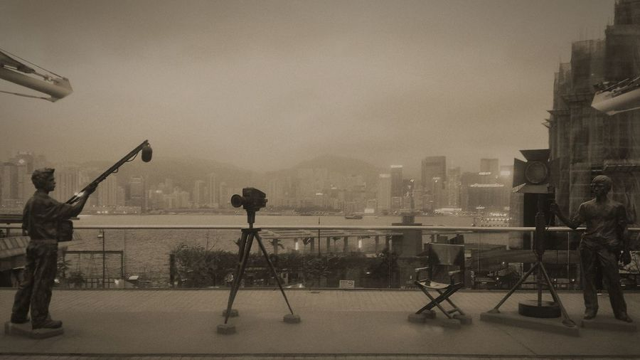 People photographing cityscape against sky