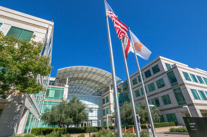 Cupertino, California, United States - August 15, 2016: the Apple world headquarters at One Infinite Loop. Apple is a multinational that produces consumer electronics, personal computers and software. people come from the popular Apple store of Apple Inc Headquarters at One Infinite Loop located in Cupertino, Silicon Valley, California. Apple California IT Mac PC United States Architecture Blue Building Building Exterior Built Structure City Clear Sky Computer Cupertino Day Electronics Industry Flag Headquarter Headquarters Hq IMac27 IPhone Imac Infinite Loop Low Angle View Mobile No People Outdoors Patriotism Sky Store Tree