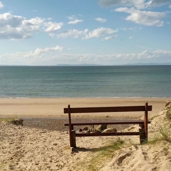 One lonely little bench. Beach Sea Sky Water bench bright sand