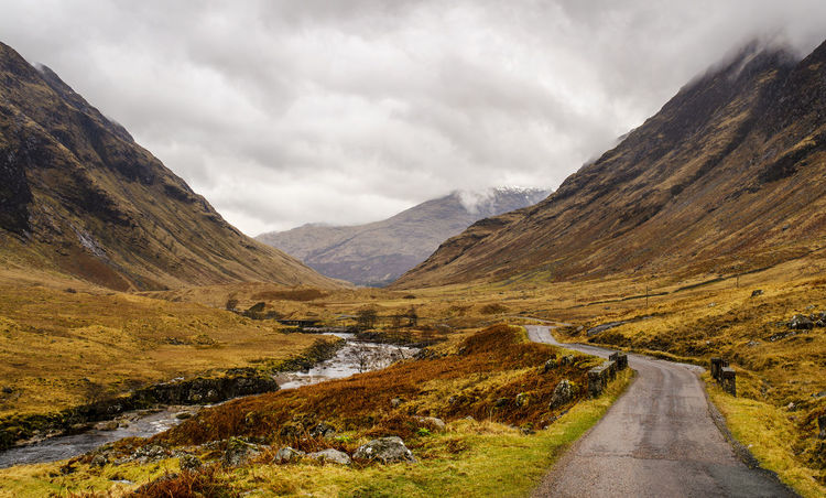 Glen Etive, Scotland River Nature Weather Hiking Sky Landscape Cloudy Grass Scotland Wanderlust Mountain Countryside Country Road Highlands Empty Road Beauty In Nature No People Schottland Etive Glen Etive Tranquil Scene Mountain Range Glenetive Non-urban Scene Cloud - Sky