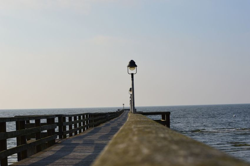 Strand und Meer Sea Water Sky Horizon Over Water Horizon Scenics - Nature Clear Sky Direction Tranquility Nature Pier Street Light Beauty In Nature No People Day Tranquil Scene The Way Forward Street Lighting Equipment Outdoors