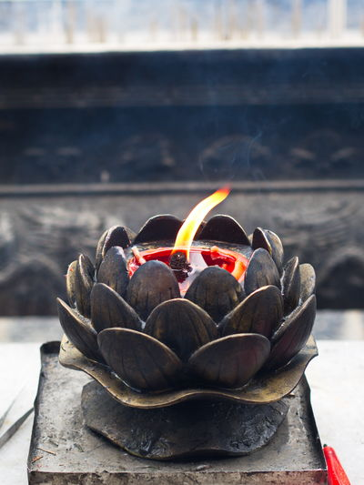 Chinese candle flame with candle oil holder in shaolin temple. dengfeng, zhengzhou city