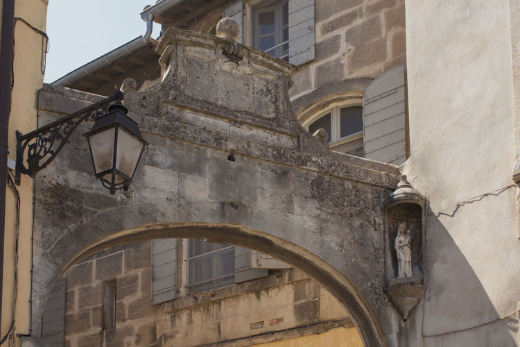 An old arch seen in the Old town, Arles Arch Arched Architecture Bad Condition Building Building Exterior Built Structure Day Deterioration Historic History Low Angle View No People Obsolete Old Old Town Outdoors The Past Tourism Travel Destinations Weathered Window
