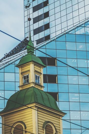 Juxtaposition in Tallinn Low Angle View Architecture Built Structure Building Exterior No People Outdoors Sky Day Glass Building Church Tallinn Estonia Juxtaposition Street The Architect - 2017 EyeEm Awards