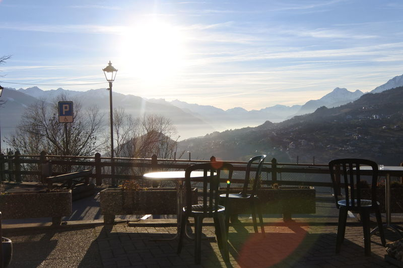 Day Mist Mountain Mountain Range Nature No People Outdoors Sky Sun Sunbeam Sunlight Tree Wheelchair Access
