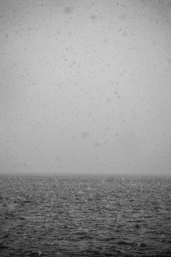 Scenic view of snowy sea against sky