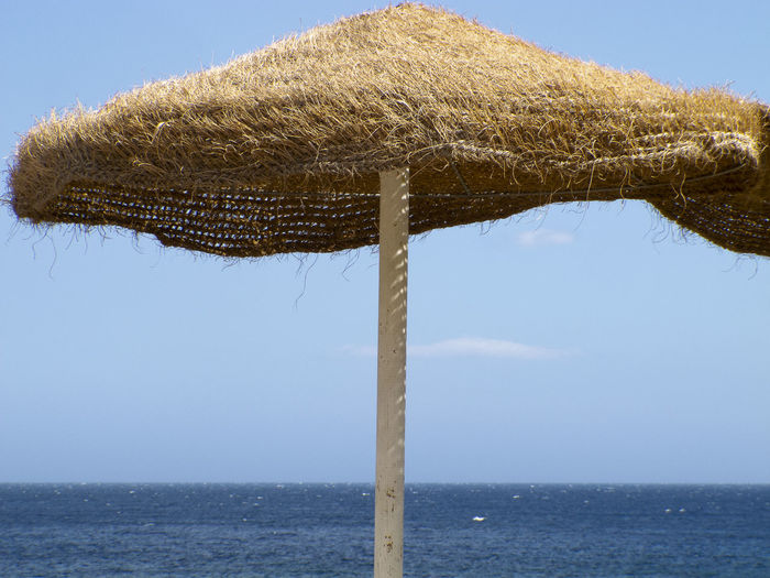 Calabria (Italy): beach umbrella with sky and blue sea in background Summertime Travel Photography Beach Beach Umbrella Beauty In Nature Clear Sky Day Horizon Horizon Over Water Land Nature No People Nobody Outdoors Protection Scenics - Nature Sea Security Sky Summer Thatched Roof Thatched Umbrella Tranquil Scene Tranquility Water