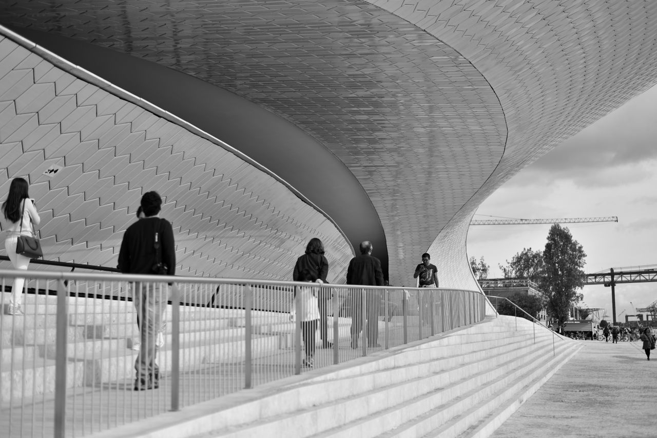 arch, real people, architecture, built structure, walking, men, lifestyles, indoors, day, women, large group of people, city, modern, sky, people