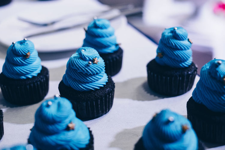 chocolate cupcake with tasty blue icing Cupcake Blue Cake Selective Focus Sweet Food No People Indoors  Indulgence Dessert Sweet Close-up Large Group Of Objects Still Life Food Food And Drink Variation In A Row Unhealthy Eating Choice Temptation Backgrounds Baking Pastry Dessert Chocolate Holiday Moments A New Perspective On Life Capture Tomorrow