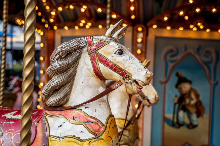View of carousel horse in amusement park