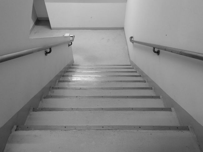 Staircase to downstair in monochrome Differing Abilities Steps And Staircases Steps Staircase Architecture Built Structure Hand Rail Stairway Spiral Stairs Stairs Narrow Fire Escape EyeEmNewHere A New Perspective On Life