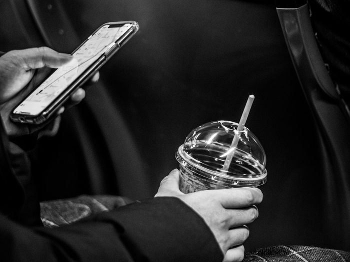 Today's world Black & White Looking Down No Talking Black Black And White Blackandwhite Blackandwhite Photography Civilization Communication Cup Holding Lifestyles Mobile Phone Phone Smartphone Starbucks Technology