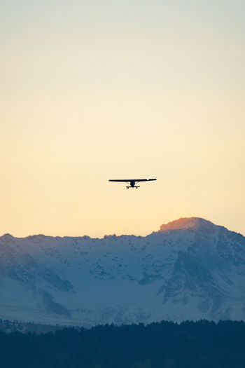 Colorado Boulder Nature Flying Sky Air Vehicle Mountain Airplane Mode Of Transportation Mid-air Transportation Beauty In Nature Sunset Scenics - Nature Copy Space Clear Sky No People Silhouette Travel Motion Mountain Range on the move Outdoors Aerospace Industry