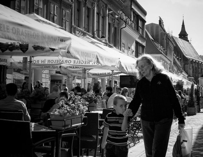 314XEL Romania Architecture Brasov Building Exterior Cafe Candid Chair City Cruceru Day Dead314XEL Grandchild Grandmother Kissing Kissing Hand Large Group Of People Leisure Activity Outdoors People Real People Sidewalk Cafe Street Streetphotography
