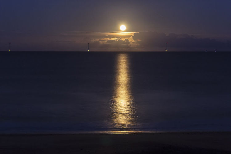 A Beaver moon rises over the North Sea at Blyth in Northumberland, UK Moon Rising Beauty In Nature Beaver Moon Blyth Horizon Over Water Illuminated Moon Nature Night No People North Sea Northumberland Outdoors Reflection Scenics Sea Sky Tranquil Scene Tranquility Uk Water