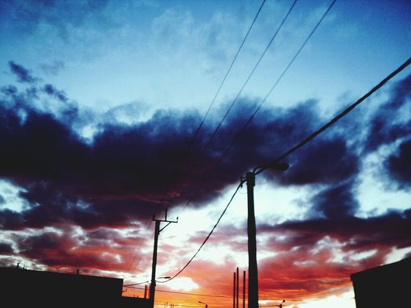 Comodoro Rivadavia Chubut Comodoro Rivadavia Sky Nature Cloud - Sky Sunset Electricity  Cable Power Supply Power Line  Connection Low Angle View Fuel And Power Generation Silhouette Technology Dusk Electricity Pylon Outdoors No People Telephone Line Electric Pole Telephone Pole First Eyeem Photo