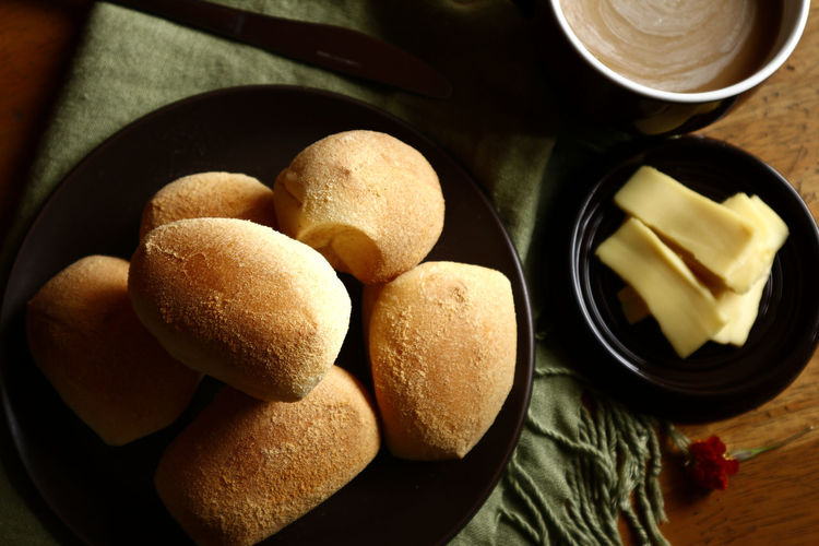 Salted bread rolls or Pandesal Food Food And Drink Drink Beverage Coffee Coffee - Drink Cheese Asianfood Filipino Food Bread Pastry Pan De Sal PANDESAL Bread Roll Dinner Rolls Salted Bread Roll Breakfast Snack Time! Meal Health Healthy Eating Healthy Food Diet Nutrition Dough Directly Above Bowl Table Close-up Food And Drink