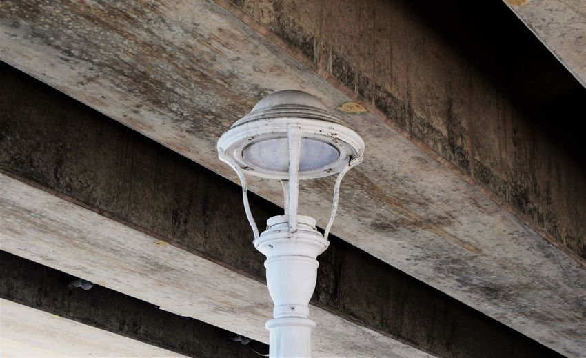 Light Beneath the Bridge Street Light Virginia Beach Wood Beams Beach Beams Bridge Beam Close-up Connection Day Focus On Foreground Light And Shadow Lighting Equipment Low Angle View No People Under Bridge Wall - Building Feature Wood - Material Wooden Beams
