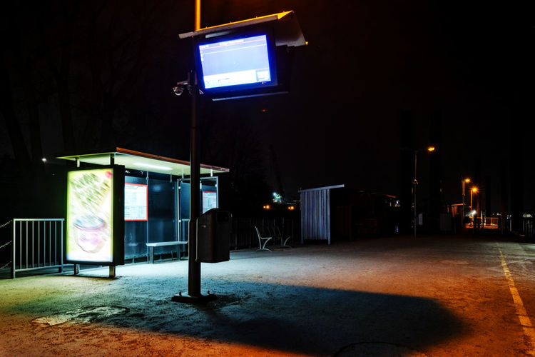 Ferry station Capture Tomorrow Night Illuminated Lighting Equipment Street Architecture City Built Structure Building Exterior Street Light No People Outdoors Glowing Light - Natural Phenomenon Dark Footpath Light Electric Light Telephone Booth Road Nature Nightlife Electric Lamp