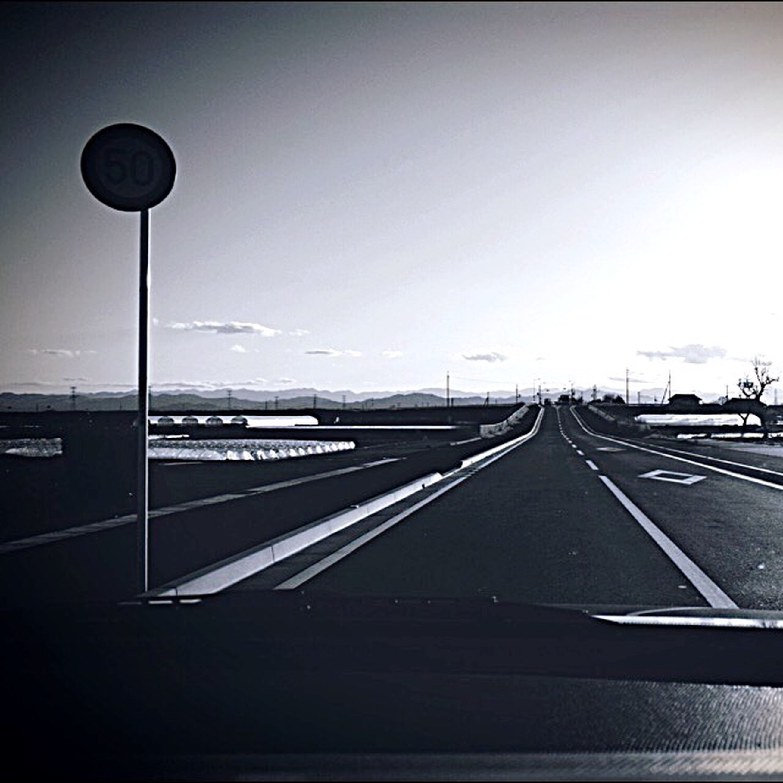 transportation, the way forward, road, road marking, diminishing perspective, street light, vanishing point, sky, clear sky, car, highway, street, empty, copy space, mode of transport, long, land vehicle, connection, asphalt, outdoors