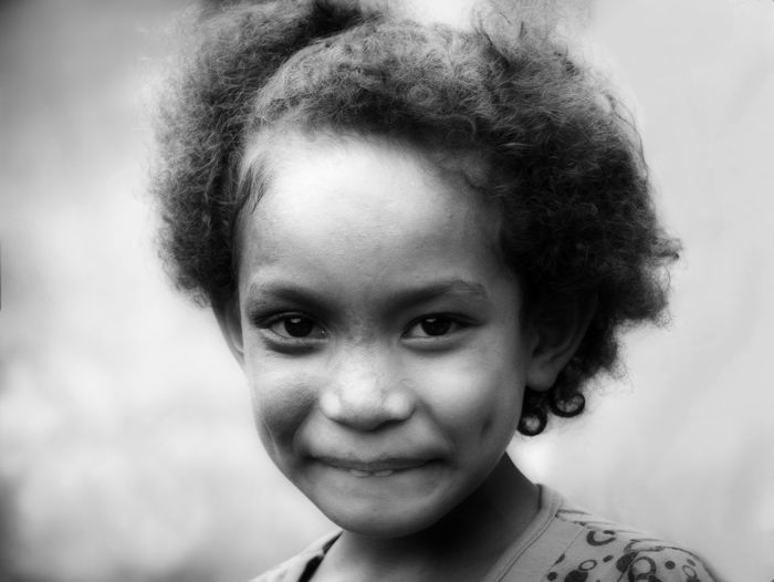 Girl from Abana, Timor Leste TIMOR LESTE Cheerful Child Childhood Close-up Day Elementary Age Front View Girls Happiness Headshot Human Face Looking At Camera One Person People Portrait Real People Shy Smiling The Portraitist - 2018 EyeEm Awards Moments Of Happiness