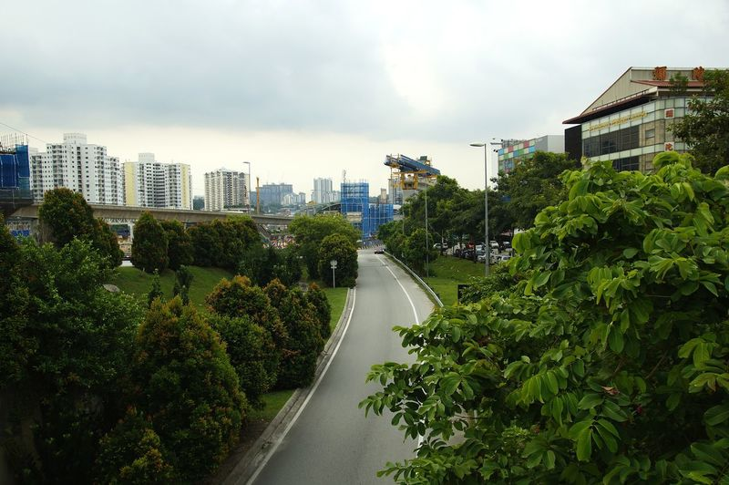 High angle view of road amidst buildings against sky