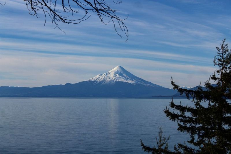 Mountain Snow Cloud - Sky Travel Destinations Lake Triangle Shape Scenics Travel Water Tranquility Winter Tree Outdoors Landscape Nature No People Beauty In Nature Day Sky VolcanOsorno VolcanOsono Chile Hermoso Beautifil Nature Volcano Lagollanquihue Surdechile!