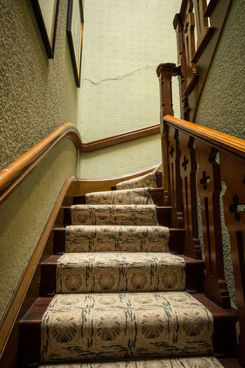 A spiral staircase with wooden handrails. Retro Staircases Steps Carpet Floral Floral Wallpaper Hand Rail Handrail  Indoors  No People Pictures Railing Spiral Staircase Staircase Perspective Stairs Steps Steps And Staircase Steps And Staircases Vintage Wallpaper Wooden Handrail