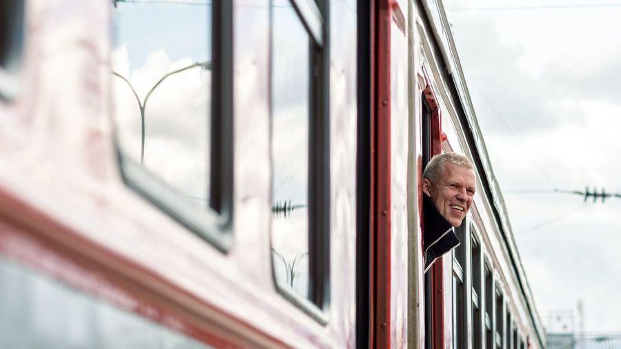 Portrait of smiling man on train window