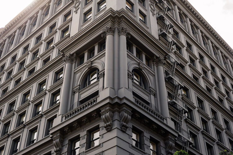 Facade of European Traditional Building Apartment Pattern Architectural Column Balcony Residential District The Past Outdoors Day No People Low Angle View Building Exterior Built Structure Window Western View USA Urban Travel Traditional Town Tourism Street Sky Outdoor Old Landmark House History Historic Famous Façade Exterior European  Europe Downtown Design Corner Cityscape City Building Architecture Ancient