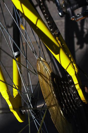 Full frame shot of yellow bike frame and wheel detail