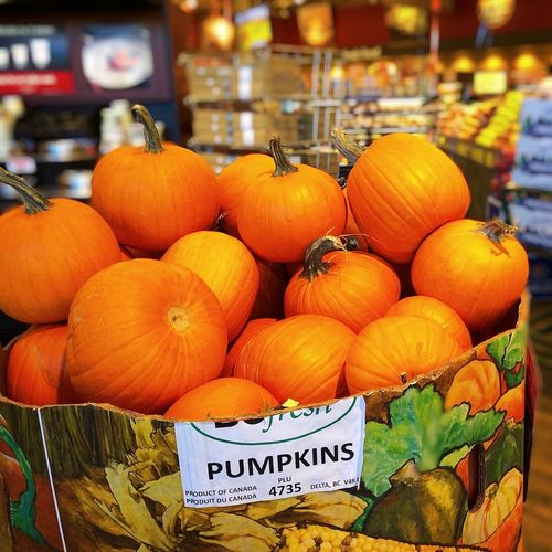 Pumpkins for sale at market stall