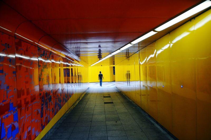Rear view of man walking in underground station