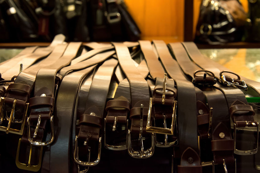 brown leather handmade belt for sale with blurred background Leather Arrangement Belt  Close-up Handmade In A Row Indoors  Leather Belt No People Sell Shadows