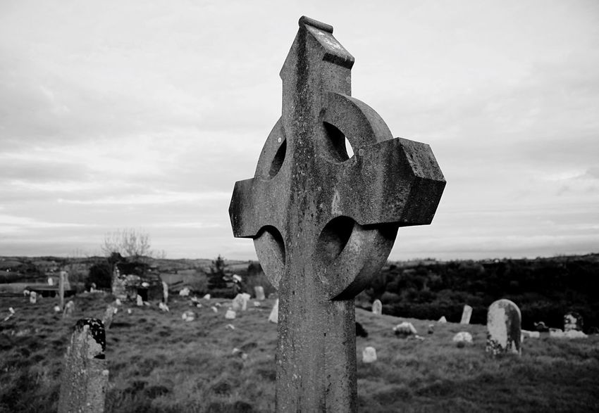 Graveyard on the land where St. Patrick had his first church. Cemetery Tombstone Sky Memorial Outdoors Cross Day Field Graveyard No People Grave Gravestone Spirituality Landscape Nature Black And White Blackandwhite Northern Ireland Photography Stone History Black And White Friday EyeEmNewHere